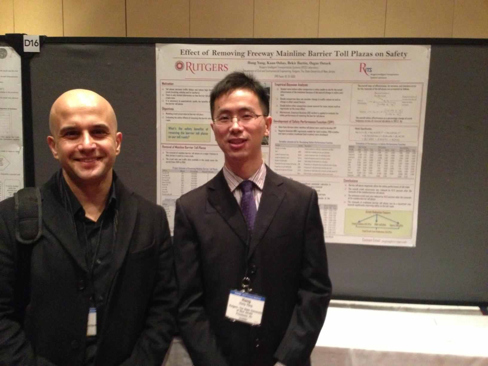 Drs. Bartin and Hong of RITS lab in front of their poster presentation.
